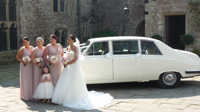 Daimler Limousine with bridesmaids