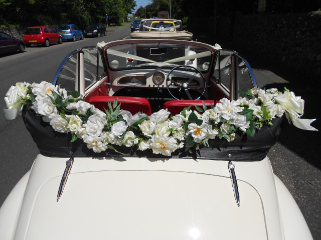 Morris Minor decorated with flowers for a wedding